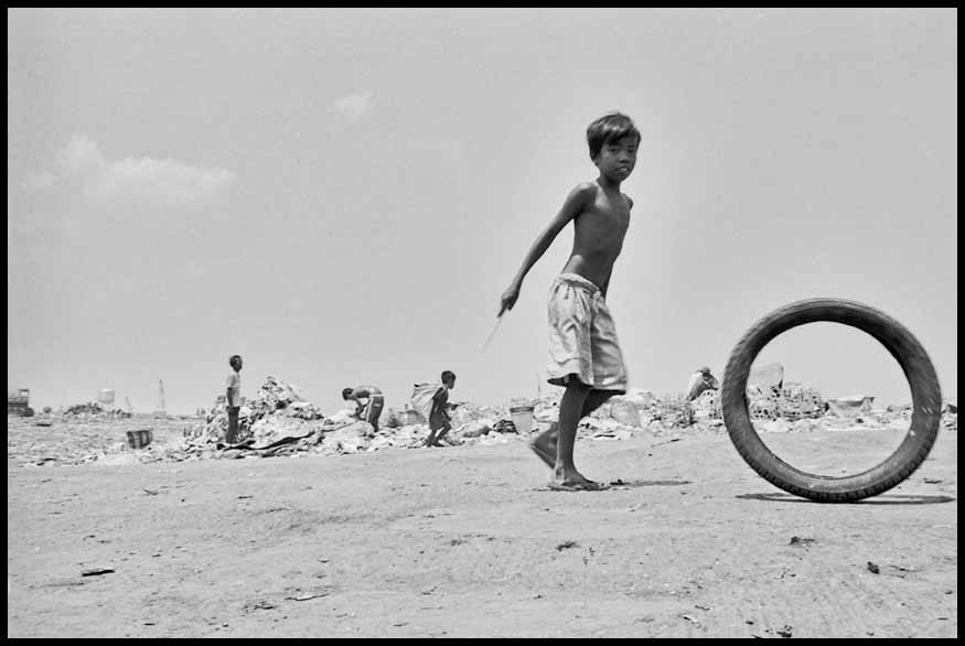27. Boy playing with motorcycle tires