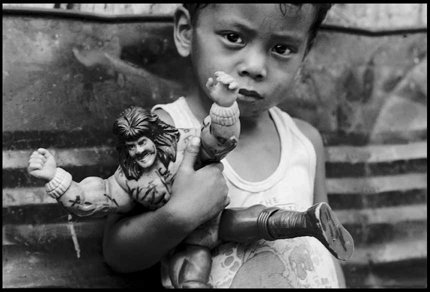 45. Boy with a plastic doll