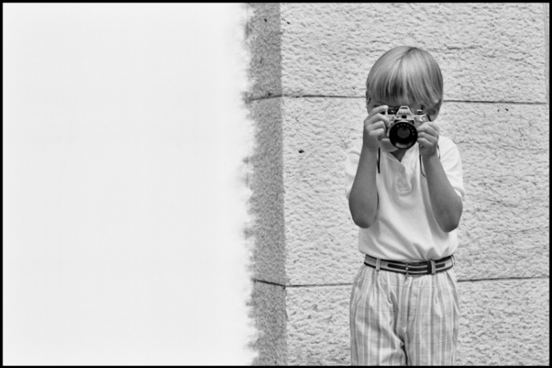 37.Child with a toy camera